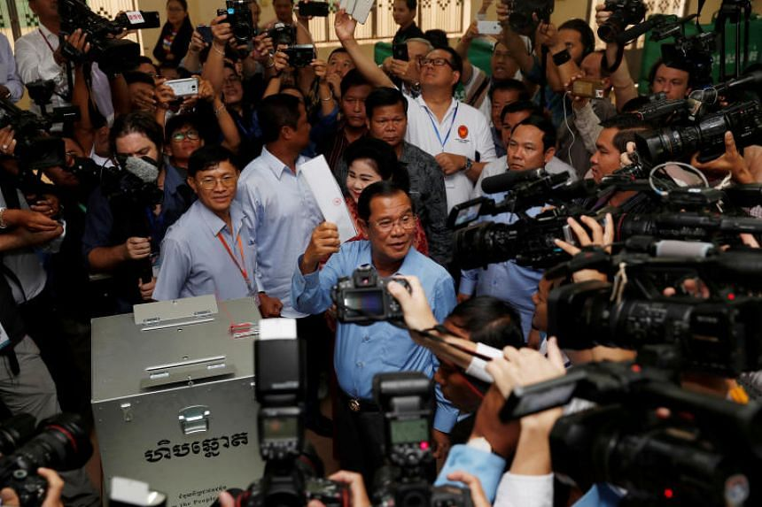 Cambodia's Prime Minister and President of the Cambodian People's Party Hun Sen prepares to cast his vote at a polling station during a general election in Takhmao on July 29, 2018.