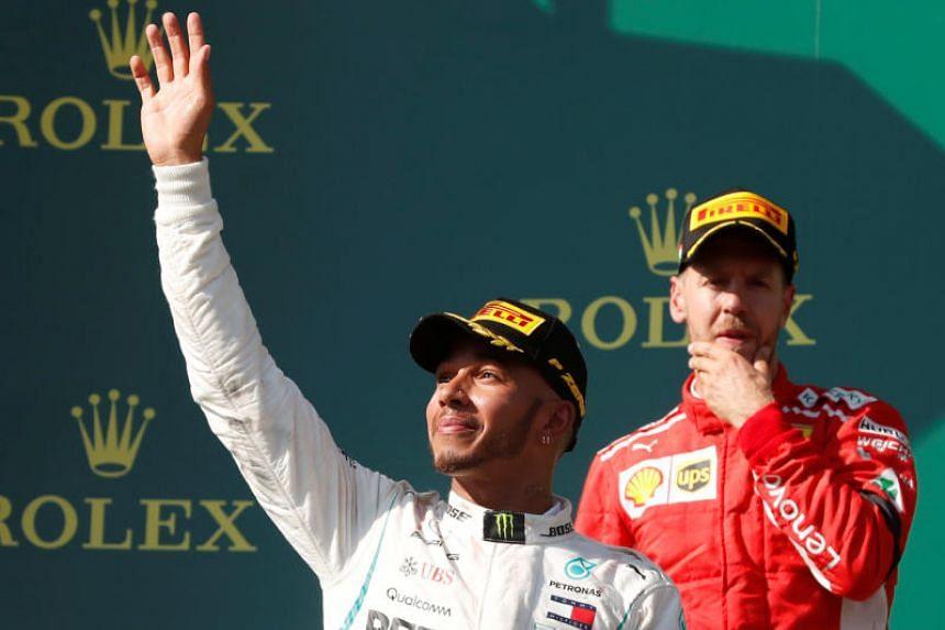 Mercedes' Lewis Hamilton celebrates on the podium after winning the race alongside second placed Ferrari's Sebastian Vettel in Budapest, Hungary, on July 29, 2018.