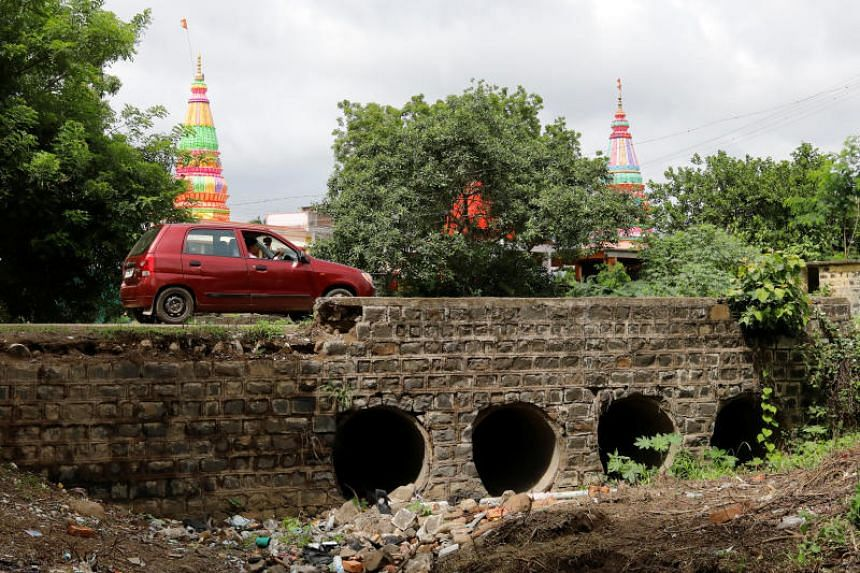 A car goes past the site where IT worker Mohammed Azam was killed in a mob lynching attack in Murki village in Bidar, India.