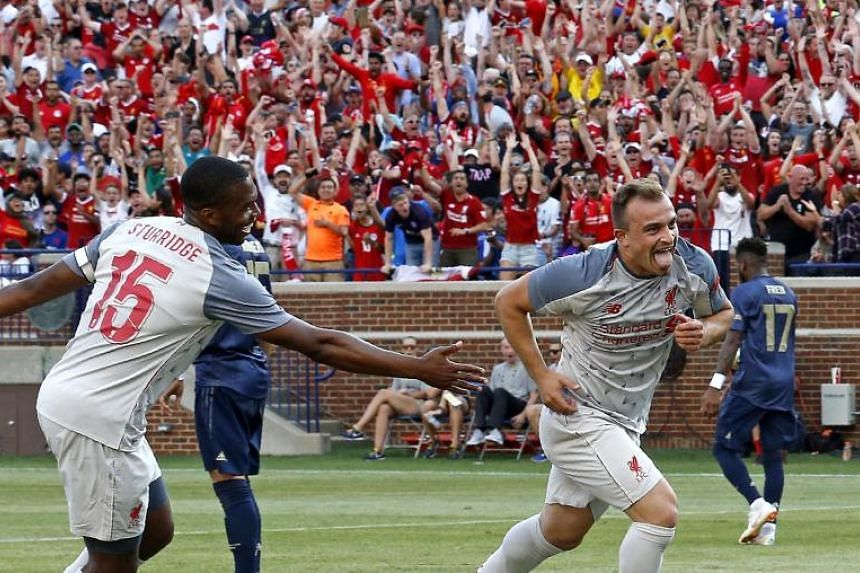 Liverpool's Xherdan Shaqiri (right) celebrating after he scored against Manchester United during a friendly in Ann Arbor, Michigan, on July 28, 2018.