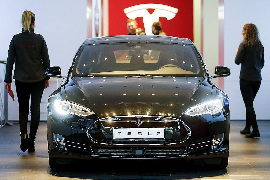 A Tesla Model S car at a dealership in Berlin, Germany. Tesla and Apple are some of the prominent companies unveiling their results, which are bound to capture the market's attention after Facebook's monster sell-off last week.