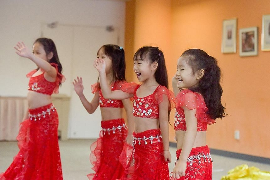 """Hoping to land a spot in this year's ChildAid concert, six-year-old Valerie Ching (right) auditioned not once but twice - first playing the violin, and later belly dancing with three other girls aged six to seven in the group Shakiya Little F4. The """""""