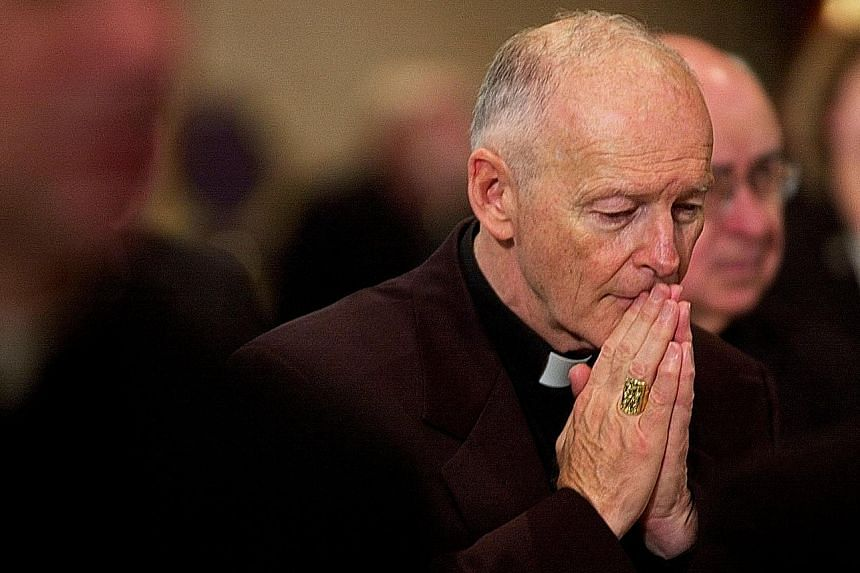 A photograph taken in 2002 of Cardinal Theodore McCarrick praying for deceased bishops at a conference in Washington, DC.