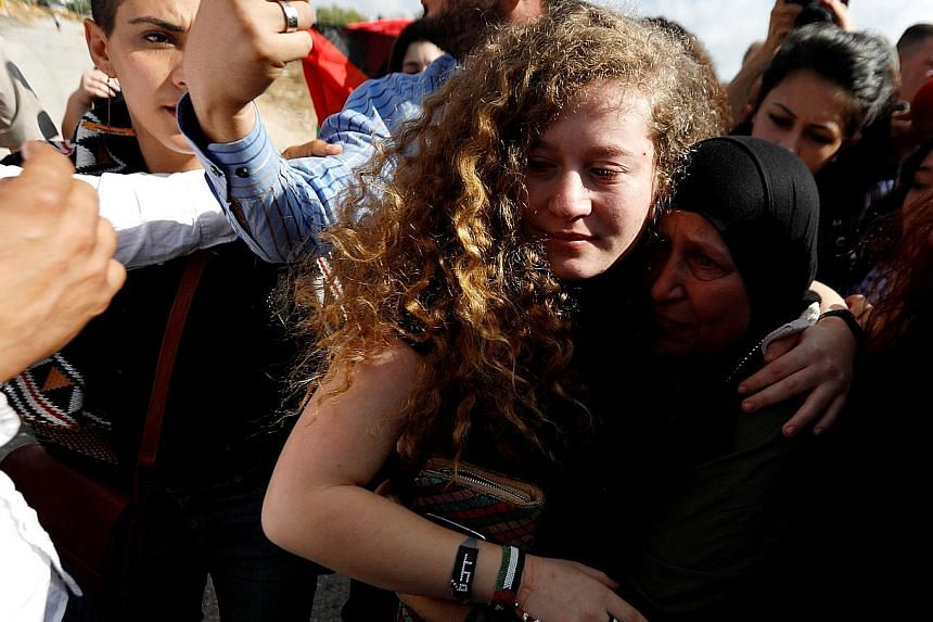 Relatives and supporters welcome Palestinian teenager Ahed Tamimi after her release from an Israeli prison, at Nabi Saleh village in the occupied West Bank. She was sentenced to eight months' imprisonment for kicking and slapping an Israeli soldier o