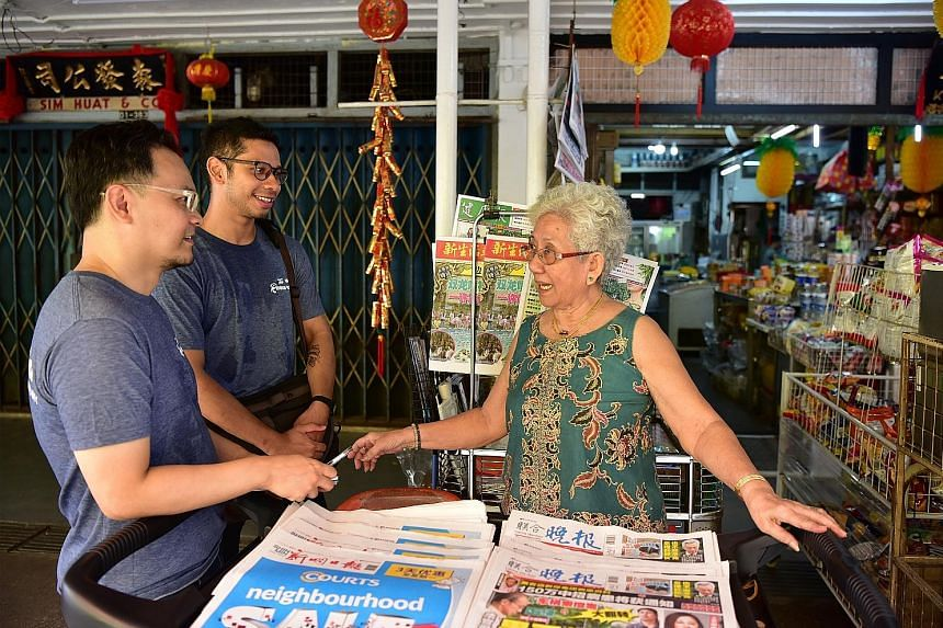 Volunteers Loh Kah Seng and Joseph Nair interviewing Madam Lim Ang Ah, 79, from Kian Seng provision shop in Tanglin Halt. Dr Loh and Mr Nair are part of a team of volunteers from civic group My Community working on a cultural project that aims to pie