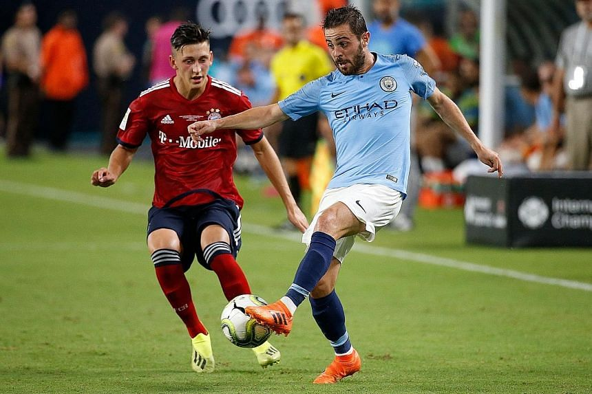 City midfielder Bernardo Silva being shadowed by Bayern defender Jonathan Meier in their ICC match at Hard Rock Stadium in Miami on Saturday. City came from behind to win and end a two-match losing run.