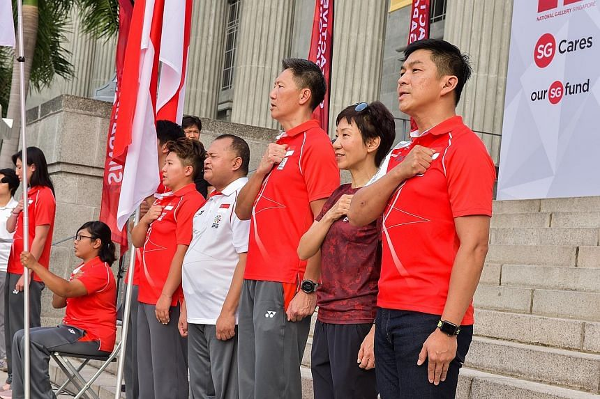 From left: Swimmer and pledge-taker Amanda Lim, para-archer Nur Syahidah Alim, paddler Koen Pang (blocked by flag), chef de mission for Youth Olympic Games Tao Li, chef de mission for Asian Para Games Ali Daud, chef de mission for Asian Games Lee Wun
