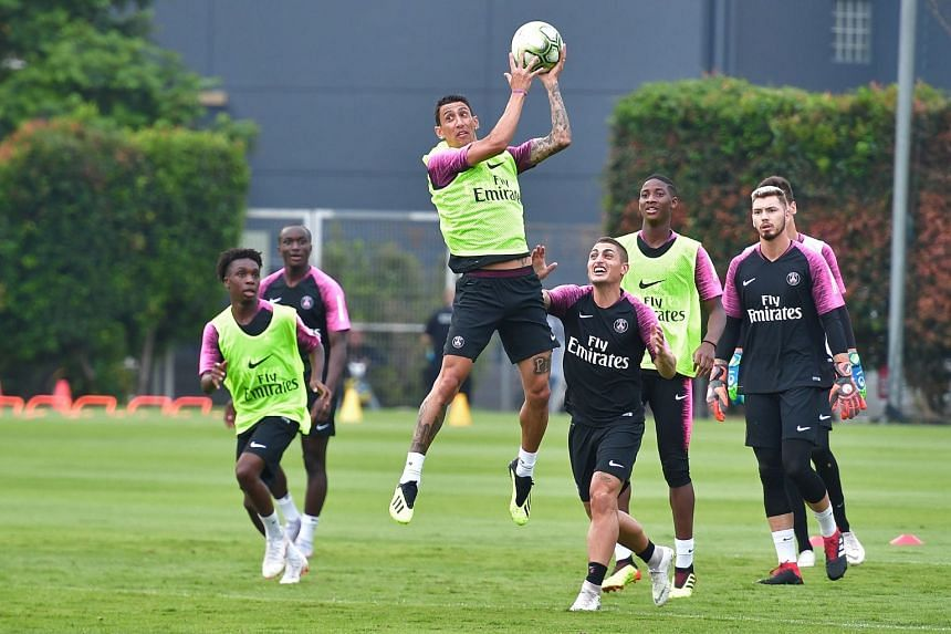 Paris Saint-Germain players, including Angel di Maria (third from left), training at Geylang Field yesterday.