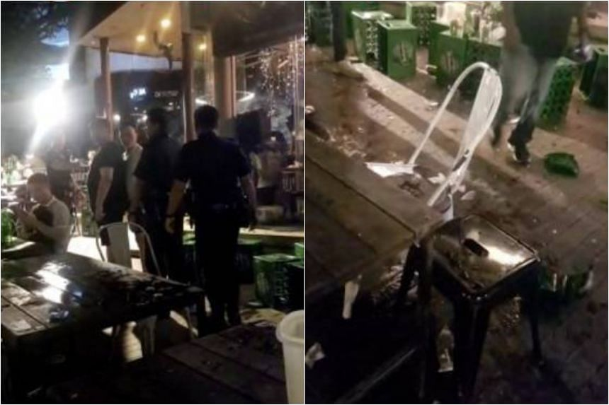 Screenshots from a video sent to citizen journalism website Stomp show beer crates toppled on the ground and at least two police officers escorting two men away.