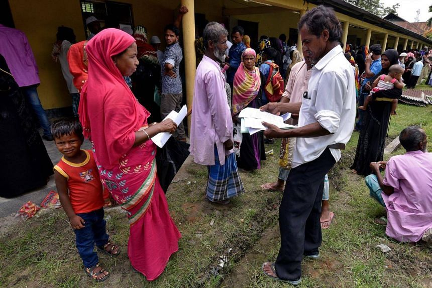 Villagers wait outside the National Register of Citizens centre to get their documents verified by government officials, at Mayong Village in Morigaon district, Assam, on July 8, 2018.