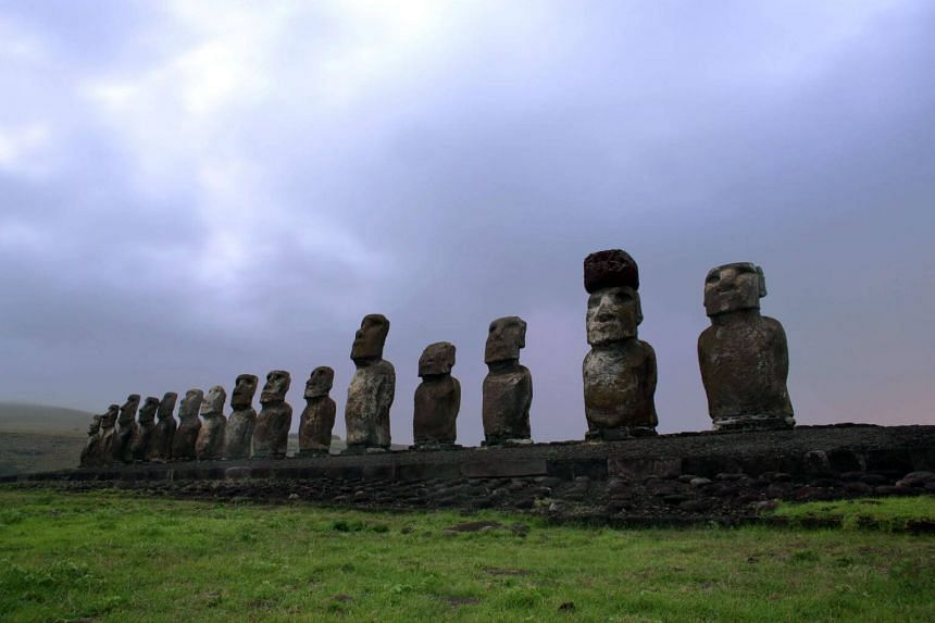 File photo showing the unique Moai statues of Easter Island, where tourists and mainland migrants have become threats to the island's well-being.