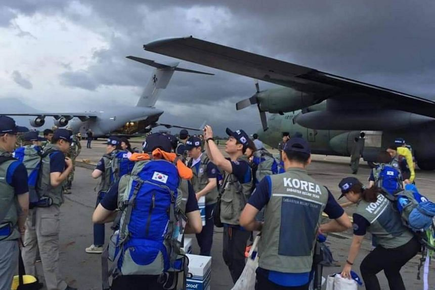 South Korean medical teams arriving in the Champassak province to provide aid and investigate the cause of the collapse of the Xe-Pian Xe-Namnoy hydropower project's saddle dam.