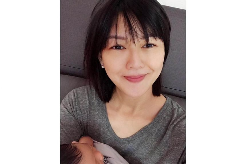"On Instagram and Facebook, Stefanie Sun shared a photo of herself holding her infant daughter with the caption: ""Mama's current status: hungry."""