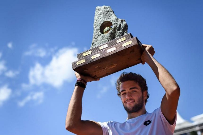 Italy's Matteo Berrettini holds the trophy as he celebrates his victory at the end of the Swiss Open ATP 250 tennis tournament final match against Spain's Roberto Bautista-Agut, on July 29, 2018 in Gstaad.