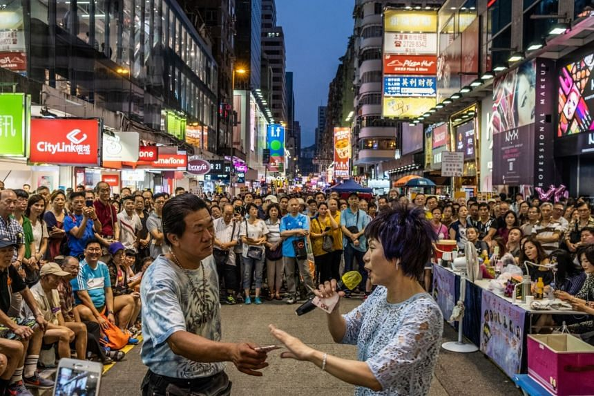 File photo showing a busker performing on Sai Yeung Choi Street South, in Hong Kong, on July 21, 2018.