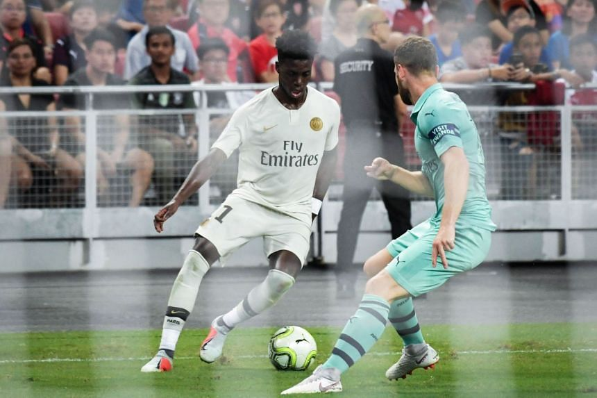 Timothy Weah trying to dribble past Shkodran Mustafi as his Paris-Saint Germain team lost 5-1 to Arsenal at National Stadium on July 28, 2018 in the International Champions Cup.