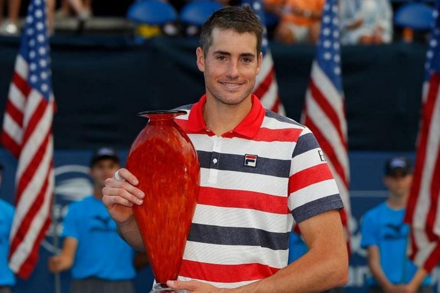 John Isner poses with his trophy after defeating Ryan Harrison during the Atlanta Open on July 29, 2018.