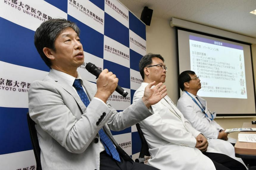 Jun Takahashi, professor at Kyoto University's Centre for iPS Cell Research and Application, speaks during a news conference in Kyoto on July 30, 2018.