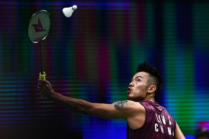 Lin Dan of China hits a shot against Mark Caljouw of the Netherlands in their men's singles match during the badminton World Championships in Nanjing, China, on July 30, 2018.