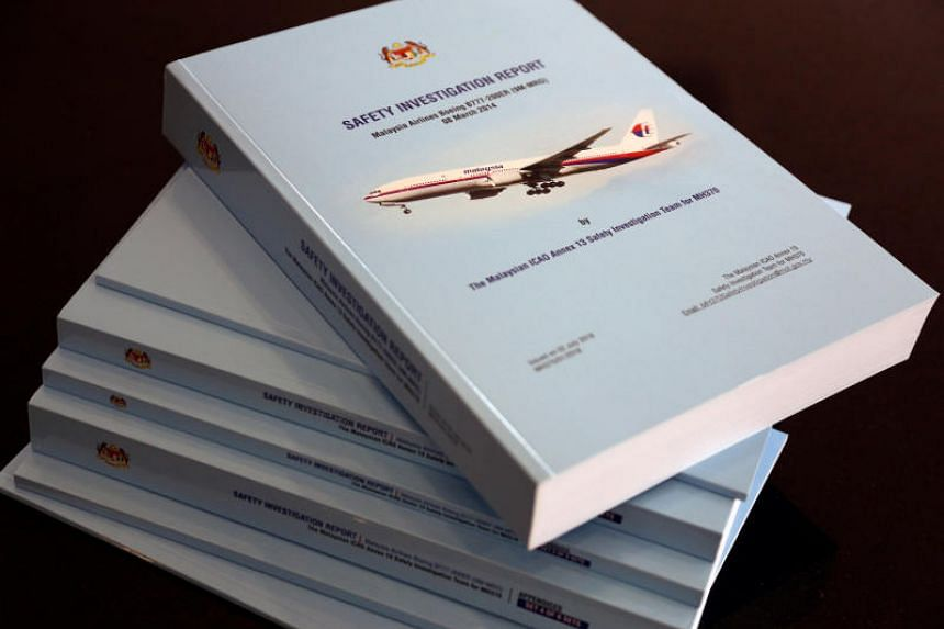 Copies of the MH370 safety investigations report are seen during a media briefing in Putrajaya, Malaysia, on July 30, 2018.
