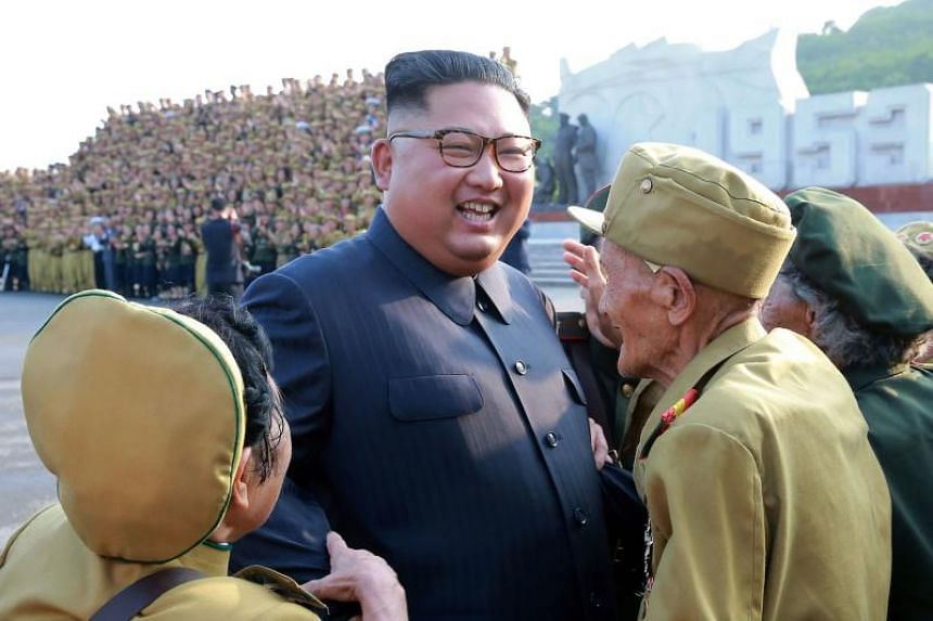 North Korean leader Kim Jong Un meets participants of the 5t National Conference of War Veterans in Pyongyang on July 27, 2018.