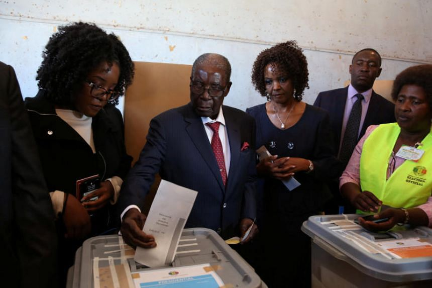 Zimbabwe's former president Robert Mugabe casts his ballot in the general elections in Harare on July 30, 2018.