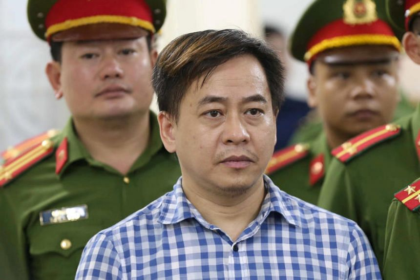 Fugitive spy Phan Van Anh Vu listens during the verdict session of his trial at a court in Hanoi on July 30, 2018.