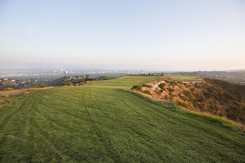 The site is the highest point in the prized 90210 zip code. It occupies a ridge in the Beverly Crest neighbourhood, adjacent to Beverly Hills, with Studio City to the north and Bel Air to the west. Previous owners include Princess Shams Pahlavi and m
