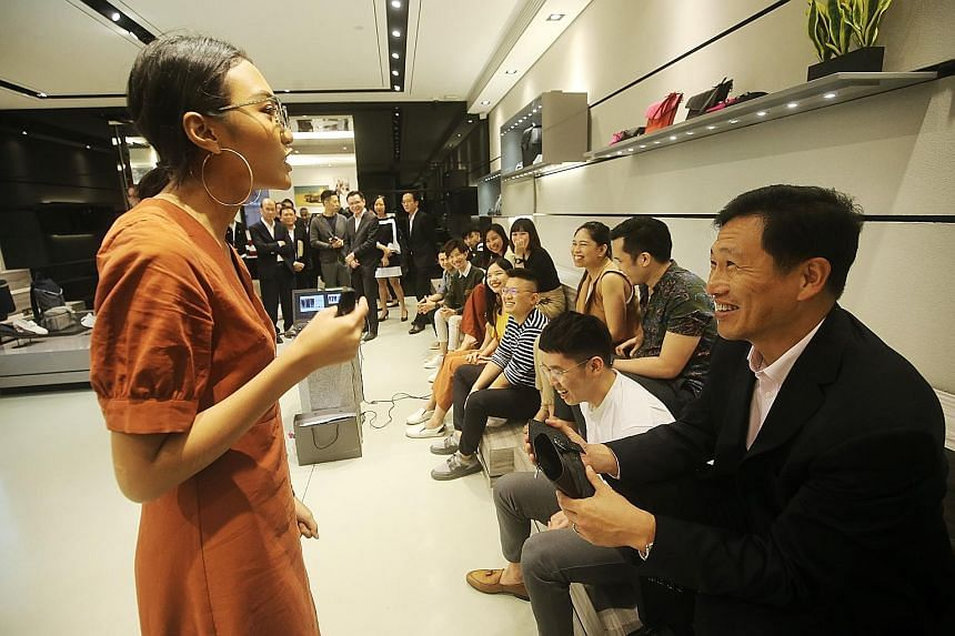 Education Minister Ong Ye Kung with Charles and Keith Group's fashion coach Jazlina Jumale during his visit to the shoe retailer yesterday. He announced the launch of the new training institute at the company's headquarters. The home-grown brand is a