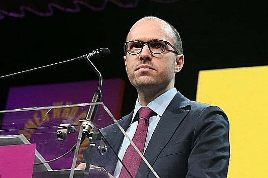 """NYT publisher A.G. Sulzberger (top) says he is """"far more concerned"""" about Mr Donald Trump's labelling journalists """"the enemy of the people"""". Mr Trump in turn accuses newspapers of being unpatriotic."""