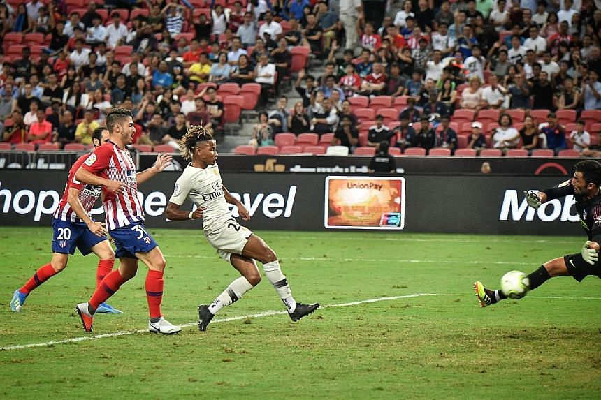 Atletico's Juanfran (No. 20) and Toni Moya are unable to stop Christopher Nkunku from scoring past goalkeeper Antonio Adan to put PSG 1-0 up. At 20, Nkunku is far from being the youngest in the PSG team.