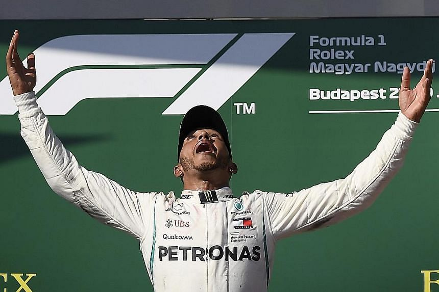 World championship leader Lewis Hamilton celebrating his Hungarian Grand Prix victory on Sunday. Mercedes are now concerned about the extra power that Ferrari are expected to generate with their new engine.