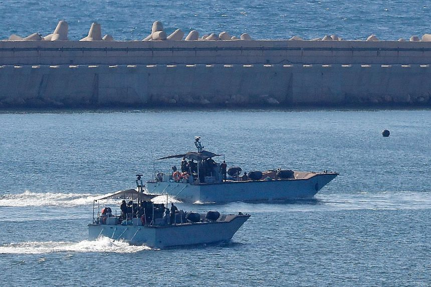 Israeli navy ships at the military port of Ashdod, Israel, on Sunday. The navy had intercepted a Norwegian-flagged activist boat trying to break a decade-plus blockade of the Gaza Strip, said the military and an activist group. The boat carrying 22 p