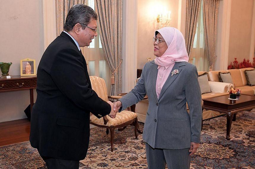 Above: Datuk Saifuddin meeting President Halimah Yacob yesterday, where she expressed Singapore's commitment to strengthen bilateral ties with Malaysia. Right: Mr Saifuddin with Foreign Minister Vivian Balakrishnan. They discussed ways to boost bilat