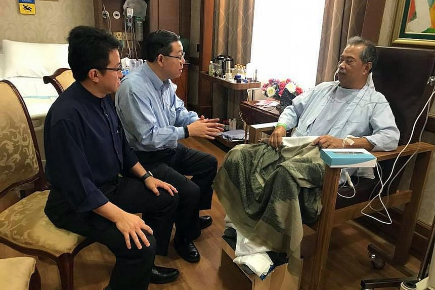 Below: (From left) Deputy Defence Minister Liew Chin Tong and Finance Minister Lim Guan Eng with Tan Sri Muhyiddin. Left: Malaysian Home Affairs Minister Muhyiddin Yassin being visited by (from far left) Education Minister Maszlee Malik and Deputy Pr
