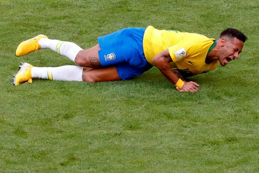 """File photo of Brazilian forward Neymar, who has been ridiculed all over the world for his """"exaggerated"""" reactions, faking injuries and excessive diving."""