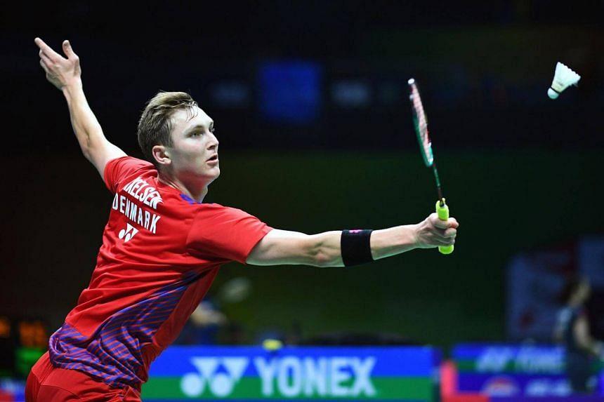 Viktor Axelsen of Denmark hitting a shot during the men's singles match of the badminton World Championships in Nanjing, Jiangsu province, on July 30, 2018.