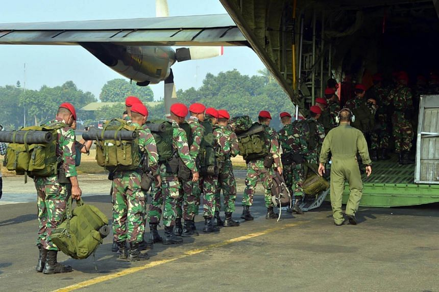 The Indonesian Kopassus special forces troops leaving an air base in East Jakarta for Lombok to rescue over 500 people stuck on a popular tourist mountain on Lombok.