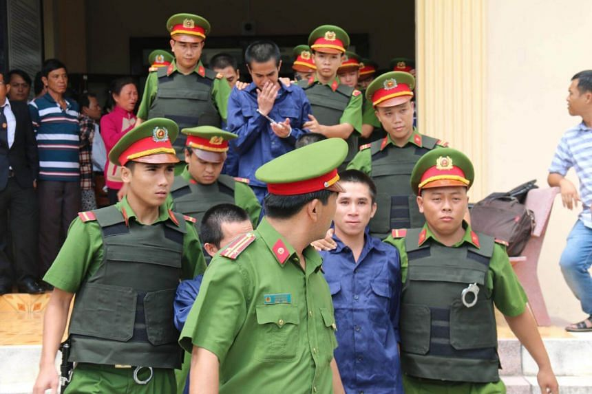 Police escorting detained protesters from a courthouse in Binh Thuan, southern Vietnam, on July 23, 2018. The protesters have been convicted for participating in a violent protest over a draft law on a special economic zone.