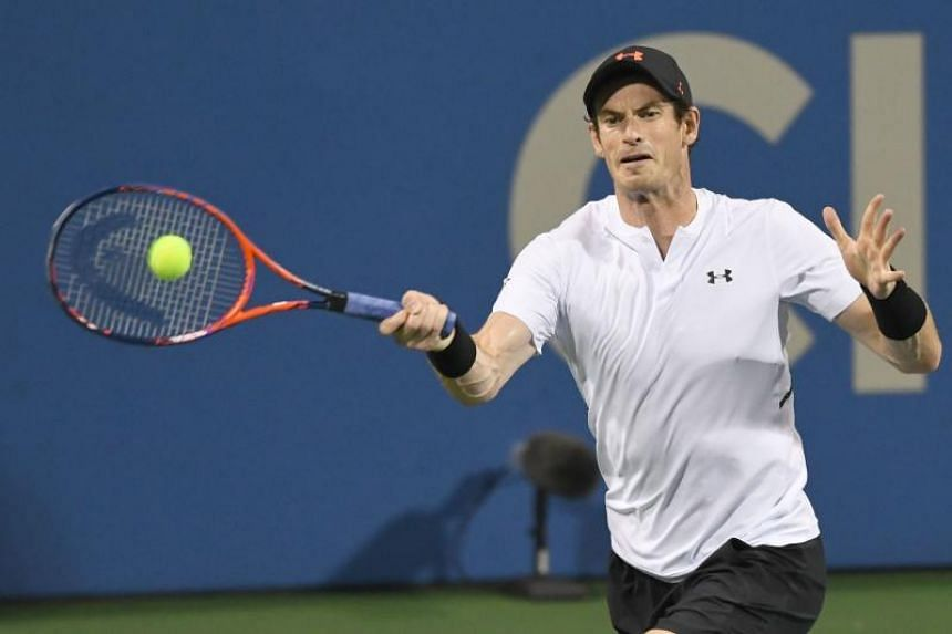 Andy Murray returns a forehand to Mackenzie McDonald during their first-round match at the Washington Open on July 30, 2018.