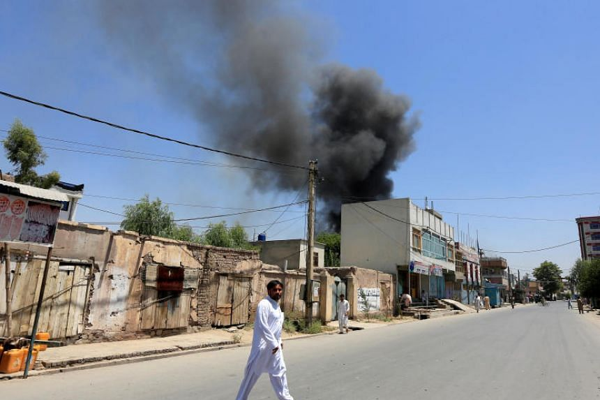 Smoke rises from an area where explosions and gunshots were heard in Jalalabad, Afghanistan, on July 31, 2018.