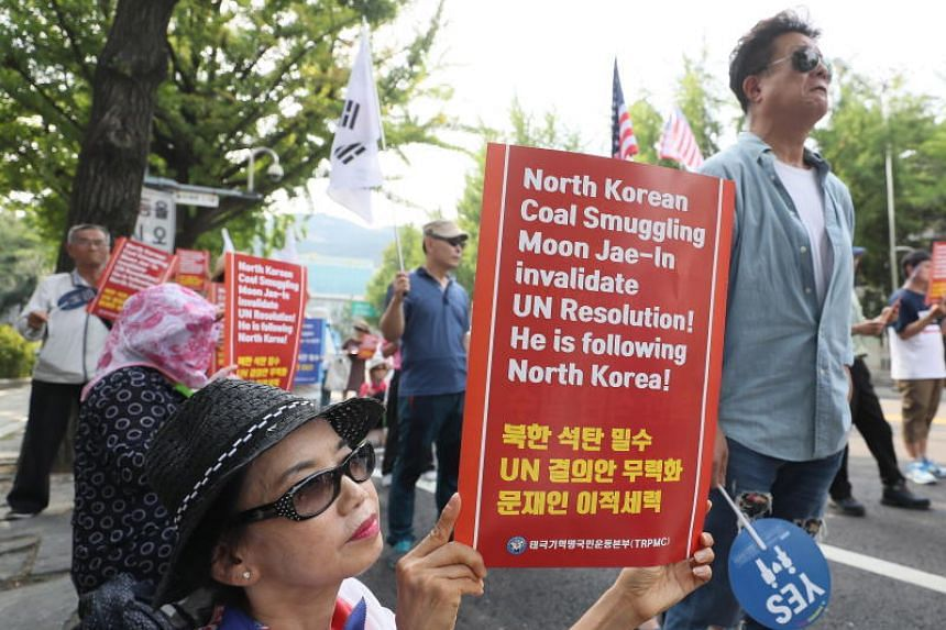 A group of activists stages a rally in Seoul, South Korea, on July 23, 2018.
