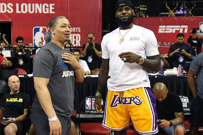 LeBron James of the Los Angeles Lakers talks to Cleveland Cavaliers' head coach Tyronn Lue after a 2018 NBA Summer League game between the Lakers and the Detroit Pistons in Las Vegas on July 15, 2018.