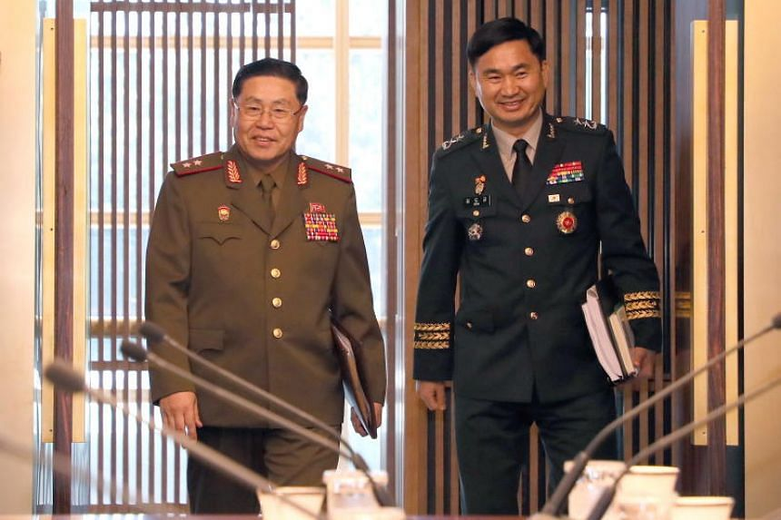 South Korea's chief delegate Major Gen. Kim Do-gyun (right) and his North Korean counterpart Lt. Gen. An Ik San arrive for the inter-Korean military meeting at the Peace House in Paju, South Korea, on July 31, 2018.