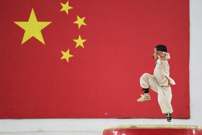 A student of Shaolin martial arts performs in Zhengzhou, China, on June 6, 2018.