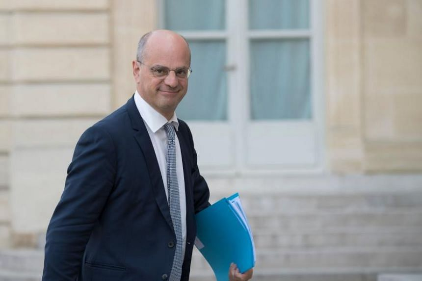 French Education Minister Jean-Michel Blanquer looks on as he arrives at The Elysee Palace in Paris on July 17, 2018, to participate in the mobilisation of companies for territories.