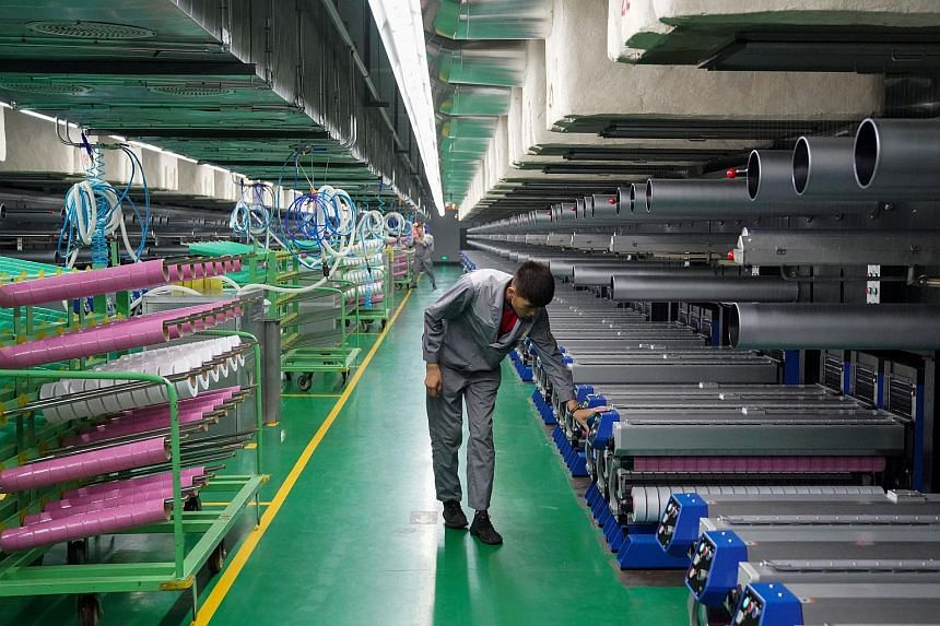 A worker inspects machines at a factory in Yinchuan, Ningxia Hui Autonomous Region, China, on July 24, 2018.