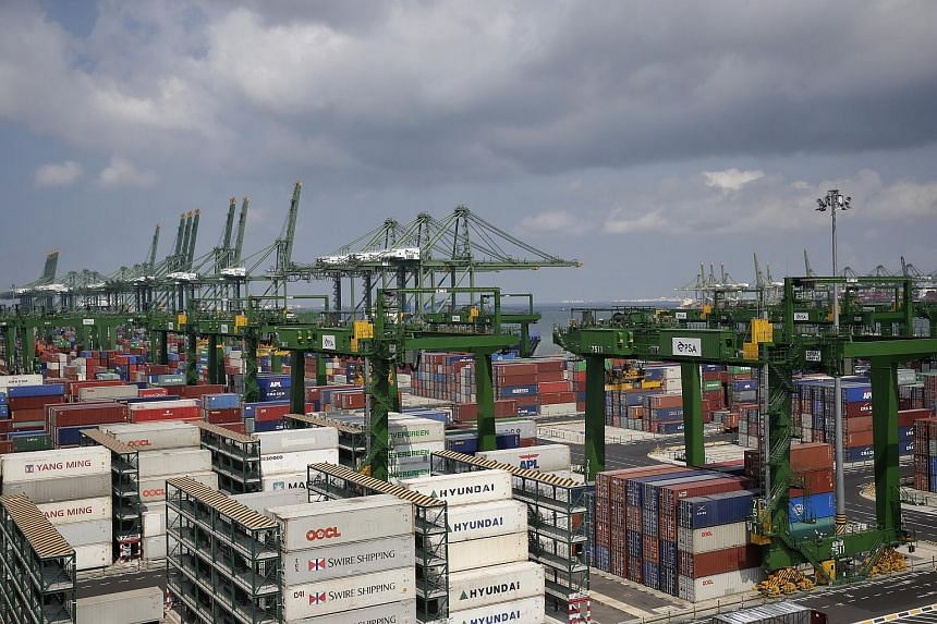 Containers and heavy equipment seen at Pasir Panjang Terminal, on July 24, 2017.