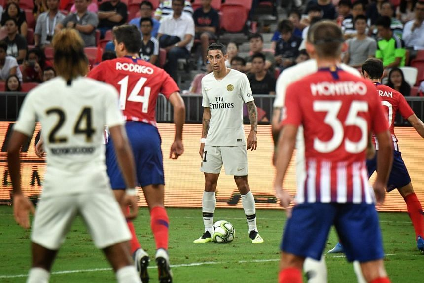 PSG's Angel di Maria on the ball at the edge of Atletico Madrid's penalty box during the first half of the ICC match on July 30, 2018 at the National Stadium.