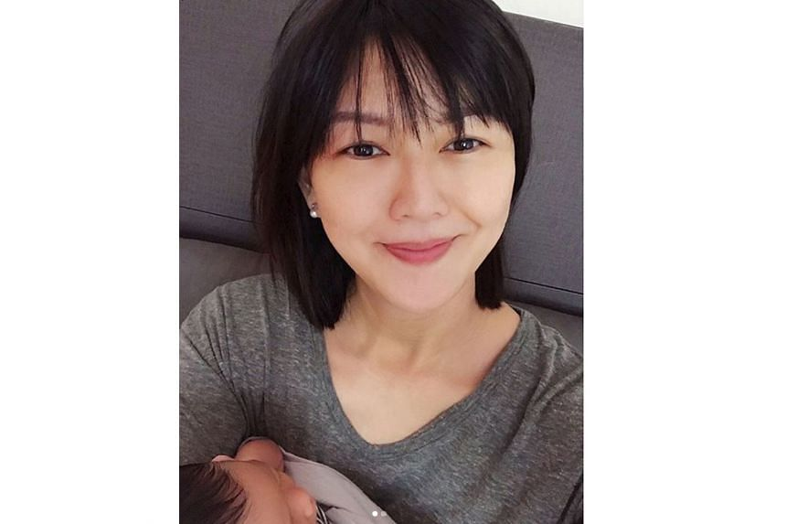 """Stefanie Sun shared a photo of herself holding her newborn girl with the caption: """"Mama's current status: hungry."""""""